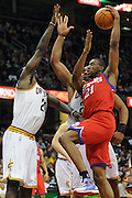 Feb. 27, 2011; Cleveland, OH, USA; Philadelphia 76ers forward Thaddeus Young (21) shoots over Cleveland Cavaliers power forward J.J. Hickson (21) during the fourth quarter at Quicken Loans Arena. The 76ers beat the Cavaliers 95-91.Mandatory Credit: Jason Miller-US PRESSWIRE