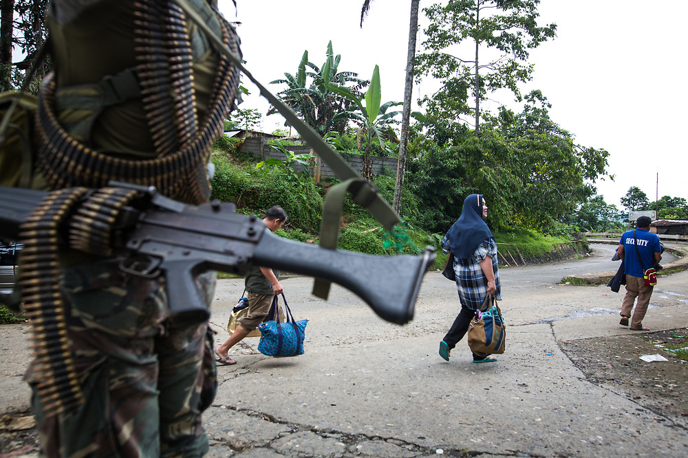 MARAWI, PHILIPPINES - JUNE 9: Civilian with their belonging escaping from the NO GO ZONE are leaving the area in Marawi, southern Philippines on June 9, 2017. Philippine military jets fired rockets at militant positions on Friday as soldiers fought to wrest control of the southern city from gunmen linked to the Islamic State group. (Photo: Richard Atrero de Guzman/NUR Photo)