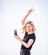 Charlize Theron takes selfie at Daytona 500, February 18, 2018. Photo by Roberto Gonzalez