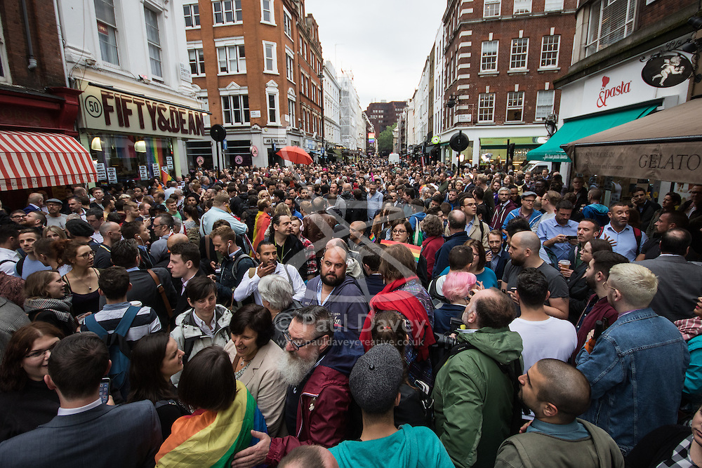 Old Compton Street, Soho, London, June 13th 2016. Thousands of LGBT people and their friends converge on Old Compton Street in London's Soho to remember the fifty lives lost in the attack on gay bar Pulse in Orlando, Florida. PICTURED: Thousands throng Old Compton Street ahead of two minutes' silence in remembrance of those killed.