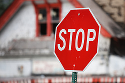 Stop sign and bandoned house near Heidelberg Project, Detroit. Michigan