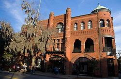 Brick building with for the Savannah Volunteer Guards, now part of the Savannah College for Art and Design, with large tree covered by Spanish Moss, Savannah, Georgia, United States of America.