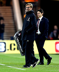 Liverpool manager Jurgen Klopp smiles as Middlesbrough manager Aitor Karanka looks frustrated - Mandatory by-line: Robbie Stephenson/JMP - 14/12/2016 - FOOTBALL - Riverside Stadium - Middlesbrough, England - Middlesbrough v Liverpool - Premier League
