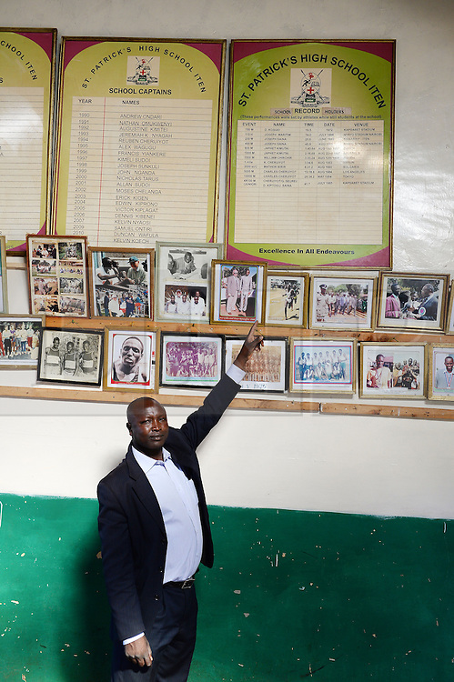 © Licensed to London News Pictures. 02/02/2014. Iten, Kenya.  Running in Africa feature. The headmaster of St. Patrick's school proudly points to the record board. Photo credit : Mike King/LNP
