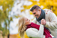 Mature couple enjoying autumn and showing affection in park