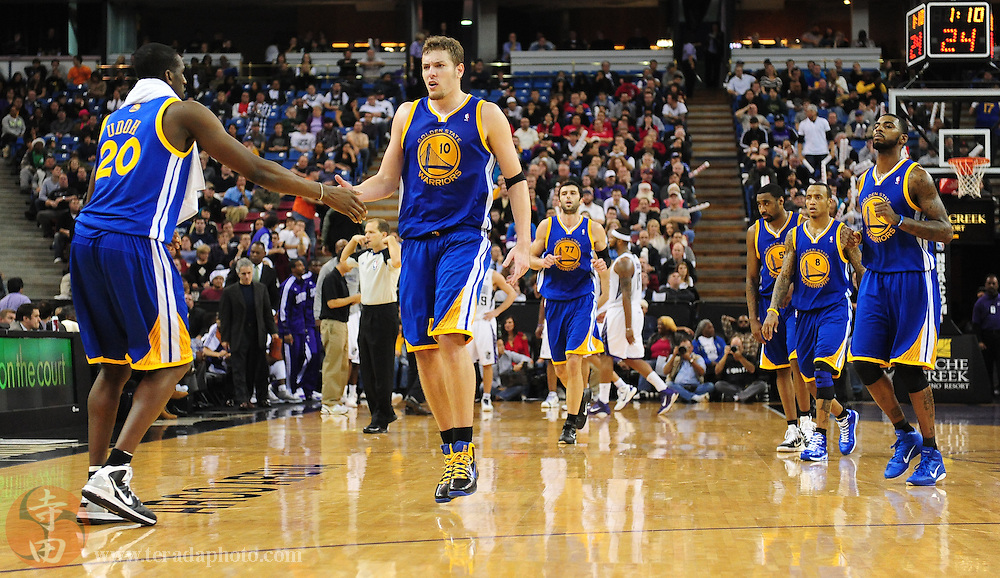 December 21, 2010; Sacramento, CA, USA; Golden State Warriors center David Lee (10) celebrates with power forward Ekpe Udoh (20) during overtime against the Sacramento Kings at ARCO Arena. The Warriors defeated the Kings 117-109 in overtime. Mandatory Credit: Kyle Terada-Terada Photo