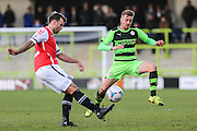 Macclesfield Town's Andy Halls clears the ball under pressure from Forest Green's Elliott Frear during the Vanarama National League match between Forest Green Rovers and Macclesfield Town at the New Lawn, Forest Green, United Kingdom on 30 January 2016. Photo by Shane Healey.