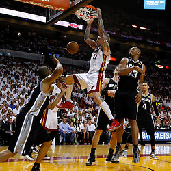 Jun 9, 2013; Miami, FL, USA;  Miami Heat power forward Chris Andersen (11) dunks against San Antonio Spurs center Boris Diaw (33) during the second quarter of game two of the 2013 NBA Finals at the American Airlines Arena. Mandatory Credit: Derick E. Hingle-USA TODAY Sports