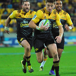 Beauden Barrett heads for the tryline during the Super Rugby match between the Hurricanes and Chiefs at Westpac Stadium, Wellington, New Zealand on Saturday, 23 April 2016. Photo: Dave Lintott / lintottphoto.co.nz