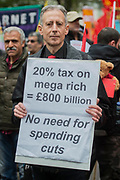 Peter Tatchell makes his point about the rich - The May Day March from Clerkenwell Green ending with a rally in Trafalgar Square - against cuts and anti 'Trade Union laws. Speakers included John McDonnell MP, Mark Serwotka PCS General Secretary and KiriTunks NUT Vice-President. It was supported by several trade unions including UNITE, PCS, ASLEF, RMT, TSSA, NUT, FBU, GMB and UNISON as well as the Peoples Assembly, Pensioners' organisations and organisations representing migrant workers & communities.