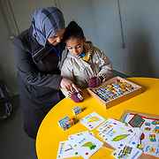 Hayam receives one-on-one tutoring with a trained instructor, which helps ensure she stays on track with her education. Zaatari camp for Syrian refugees, Jordan, March 2014.
