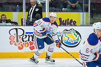 PENTICTON, CANADA - SEPTEMBER 17: Caleb Jones #81 of Edmonton Oilers skates against the Calgary Flames<br />  on September 17, 2016 at the South Okanagan Event Centre in Penticton, British Columbia, Canada.  (Photo by Marissa Baecker/Shoot the Breeze)  *** Local Caption *** Caleb Jones;