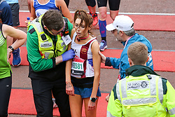 © Licensed to London News Pictures. 28/04/2019. London, UK.  A runner is helped by medical staff t the finish of 2019 Virgin Money London Marathon.Photo credit: Dinendra Haria/LNP