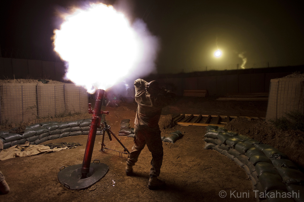 Soldiers of Apache Company 2-28 Infantry fire 120mm mortar for distance adjustment at Combat Out Post in Mata Khan in Paktika Province in Afghanistan on Aug 31, 2011..(Photo by Kuni Takahashi)