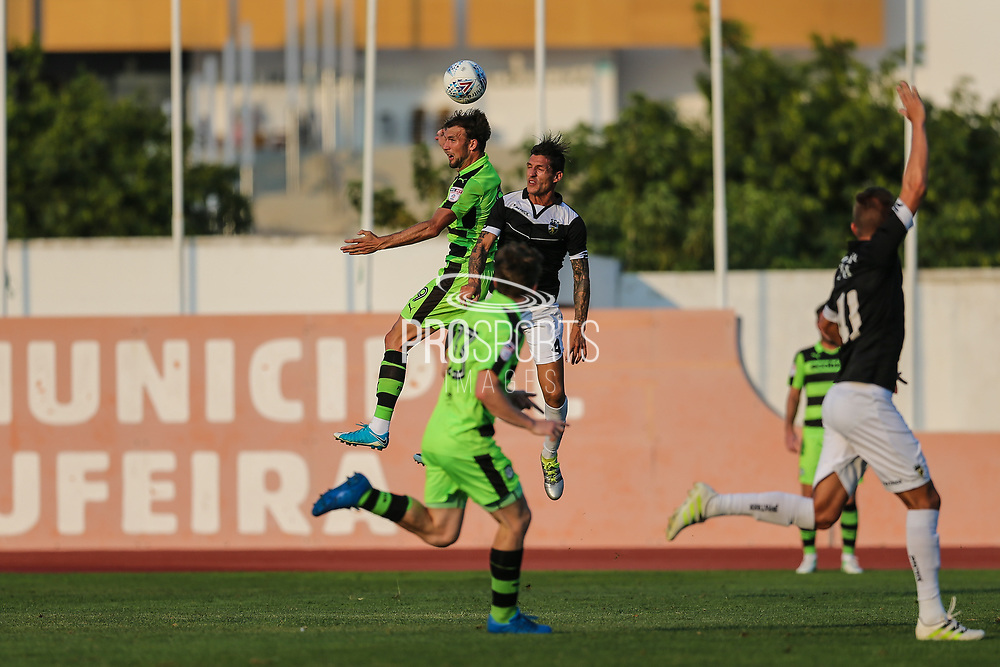 Forest Green Rovers Christian Doidge(9) wins a header during the Pre-Season Friendly match between SC Farense and Forest Green Rovers at Estadio Municipal de Albufeira, Albufeira, Portugal on 25 July 2017. Photo by Shane Healey.