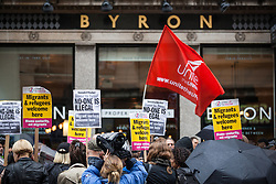 © Licensed to London News Pictures. 01/08/2016. London, UK. Hundreds demonstrate outside the Holborn branch of Byron Burger in central London after 35 of its staff were arrested for immigration offences.The Home Office carried out raids at a number of Byron restaurants across the capital last week. Photo credit: Rob Pinney/LNP