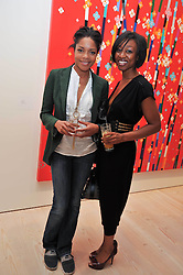 Left to right, actress NAOMIE HARRIS and singer BEVERLEY KNIGHT at an exhibition of photographic portraits by Bryan Adams entitled 'Hear The World' at The Saatchi Gallery, King's Road, London on 21st July 2009.