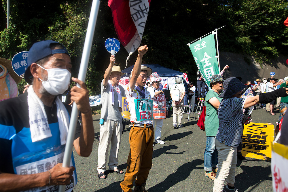 EHIME, JAPAN - AUGUST 12 : Anti-nuclear protesters gather and chant in front of Ikata Nuclear Power Plant to protest against the restarting of a nuclear reactor on August 12, 2016 in Ikata, Ehime prefecture, northwestern Shikoku, Japan. The Shikoku Electric Power Company restarted the plant's No.3 reactor at around 9 AM on Friday. It is the third plant to go online under new regulations issued after the Fukushima Daiichi nuclear disaster. (Photo by Richard Atrero de Guzman/NURPhoto)