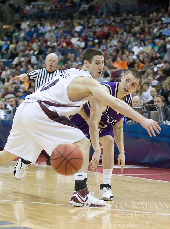 Holy Cross Crusaders guard Pat Doherty (20) moves around Southern Illinois Salukis guard Bryan Mullins (10).  The #4 seed Southern Illinois Salukis defeated the #13 seed Holy Cross Crusaders 61-51  in the first round of the Men's NCAA Tournament in Columbus, OH on March 16, 2007.
