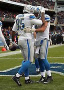 Detroit Lions tight end Eric Ebron (85) celebrates with Detroit Lions quarterback Matthew Stafford (9) after Ebron catches a one yard touchdown pass good for a 24-17 fourth quarter Lions lead during the NFL week 17 regular season football game against the Chicago Bears on Sunday, Jan. 3, 2016 in Chicago. The Lions won the game 24-20. (©Paul Anthony Spinelli)
