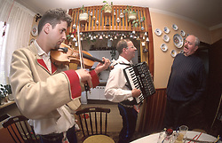 CZECH REPUBLIC MORAVIA BANOV APR98 -  Jan Chovanec (L) plays the violin for his elderly hosts Helena and Josef Vystrcil at their home.  During Easter, folklore dress, music and mutual visits are part of the customary traditional celebrations in Moravia.  jre/Photo by Jiri Rezac<br /> <br /> &copy; Jiri Rezac 1998<br /> <br /> Tel:   +44 (0) 7050 110 417<br /> Email: info@jirirezac.com<br /> Web:   www.jirirezac.com