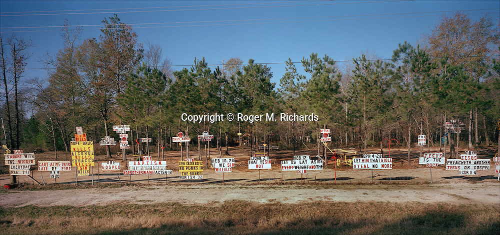 Religious signs along a roadway in Mississippi. Photograph by Roger M. Richards