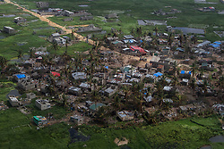 March 27, 2019 - Beira, Mozambique - An aerial view of damaged homes in the community of Beira City after it was hit by Cyclone Idai last week. The deadly cyclone and hammering rains have left more than 1000 people dead in Mozambique alone. It is one of the largest humanitarian disasters the region has ever faced. It is estimated by the UN that 350,000 people are still at risk. UNICEF warned that 900,000 children have been affected; either orphaned, separated from their families or lacking basic necessities. (Credit Image: © Tafadzwa Ufumleli/ZUMA Wire)