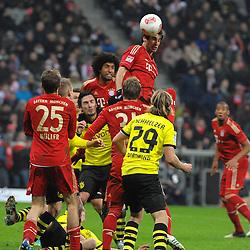 01-12-2012 VOETBAL: FC BAYERN MUNCHEN - BORUSSIA DORTMUND: MUNCHEN<br /> Javier MARTINEZ (FC Bayern Muenchen) springt am Hoechsten <br /> ***NETHERLANDS ONLY***<br /> ©2012-FotoHoogendoorn.nl