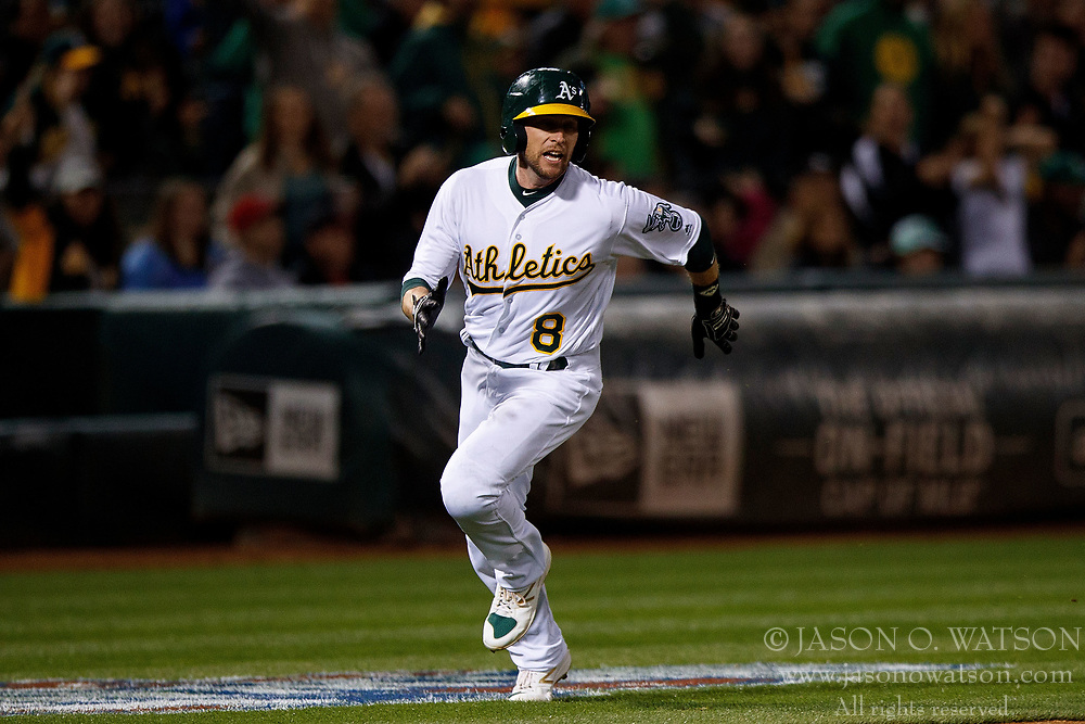 OAKLAND, CA - APRIL 04:  Jed Lowrie #8 of the Oakland Athletics rounds third base to score a run against the Los Angeles Angels of Anaheim during the seventh inning at the Oakland Coliseum on April 4, 2017 in Oakland, California. The Los Angeles Angels of Anaheim defeated the Oakland Athletics 7-6. (Photo by Jason O. Watson/Getty Images) *** Local Caption *** Jed Lowrie