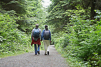 Couple on forest trail rear view