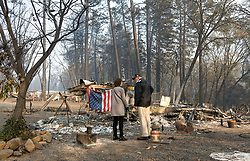 November 17, 2018 - Paradise, California, U.S. - President DONALD TRUMP surveys the damage with Paradise Mayor JODY JONES as they tour the Skyway Villa Mobile Home and RV Park during his visit of the Camp Fire in Paradise. The Camp Fire in Northern California has become the nation's deadliest wildfire in a century and has killed at least 63 people and left more than 1000 still missing. (Credit Image: © Paul Kitagaki Jr./ZUMA Wire)