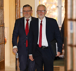 © Licensed to London News Pictures. 21/10/2019. London, UK. Barry Gardener Shadow Secretary of State for Trade and Jeremy Corbyn arrive at Church House, London to announce a major statement on the NHS. Jeremy Corbyn later holds up reductive documents that are secret talks between the Government and the US on the NHS. Photo credit: Alex Lentati/LNP