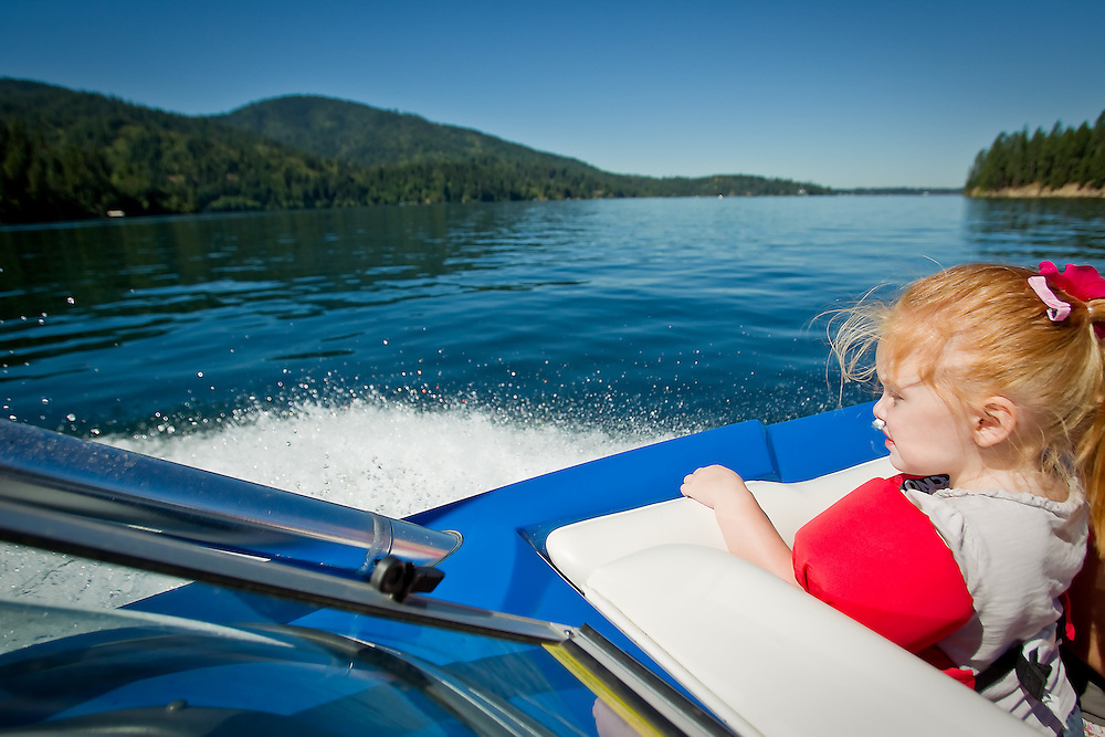 Chloe Hyder enjoys a boat ride on the lake  Sunday, July 25, 2010 while visiting family in Hayden Lake, Idaho.