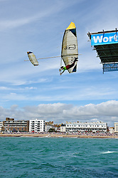 © Licensed to London News Pictures. 13/08/2011. Worthing, UK. A flyer jumps from Worthing pier, 35ft above the water aiming to fly over 100M and win the £10,000 price for the longest flight over 100M. Flying was cancelled due to high winds. Sundays (14th) event will also include fun flyers raising money for charity.  Photo credit : Julie Edwards/LNP