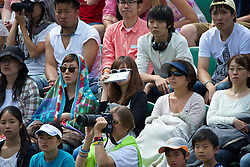 LONDON, ENGLAND - Tuesday, July 1, 2014: Japanese spectators during the Ladies' Singles 4th Round match on day eight of the Wimbledon Lawn Tennis Championships at the All England Lawn Tennis and Croquet Club. (Pic by David Rawcliffe/Propaganda)