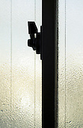 close up of frosted safety glass and frame with lock