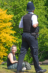 ©Licensed to London News Pictures 06/05/2020  <br /> Greenwich, UK. Policeman on patrol asking this happy lady to move on. People out and about in Greenwich park, Greenwich, London exercising and enjoying the warm sunny weather.  Photo credit:Grant Falvey/LNP