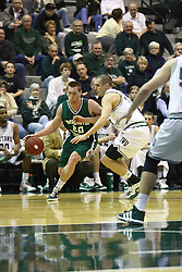 17 December 2011:  Dylan Richter takes the baseline against John Koschnitzky during an NCAA mens division 3 basketball game between the Washington University Bears and the Illinois Wesleyan Titans in Shirk Center, Bloomington IL