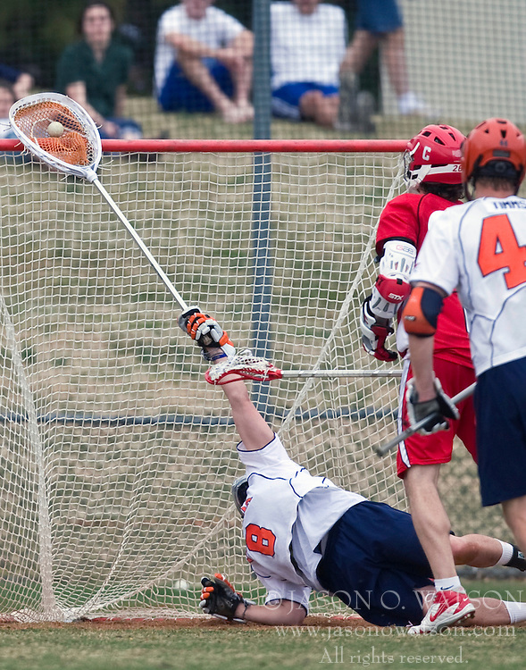 Virginia Cavaliers G Adam Ghitelman (8) makes a diving save against Cornell.  The #1 ranked Virginia Cavaliers defeated the #4 ranked Cornell Big Red 14-10 at Klockner Stadium on the Grounds of the University of Virginia in Charlottesville, VA on March 8, 2009.