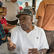 MIAMI, FLORIDA, APRIL 22, 2017<br /> Eduardo Vaillen, 78, argues as he plays  dominoes in Miami's Little Havana neighborhood's Maximo Gomez Domino Park. Many Miami Cubans voted for Donald Trump in the general elections. Trump will soon complete his first 100 days as United States President.<br /> (Photo by Angel Valentin/Freelance)