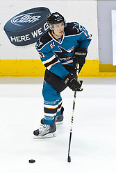 Jan 17, 2012; San Jose, CA, USA; San Jose Sharks defenseman Justin Braun (61) skates with the puck against the Calgary Flames during the third period at HP Pavilion. San Jose defeated Calgary 2-1 in shootouts. Mandatory Credit: Jason O. Watson-US PRESSWIRE