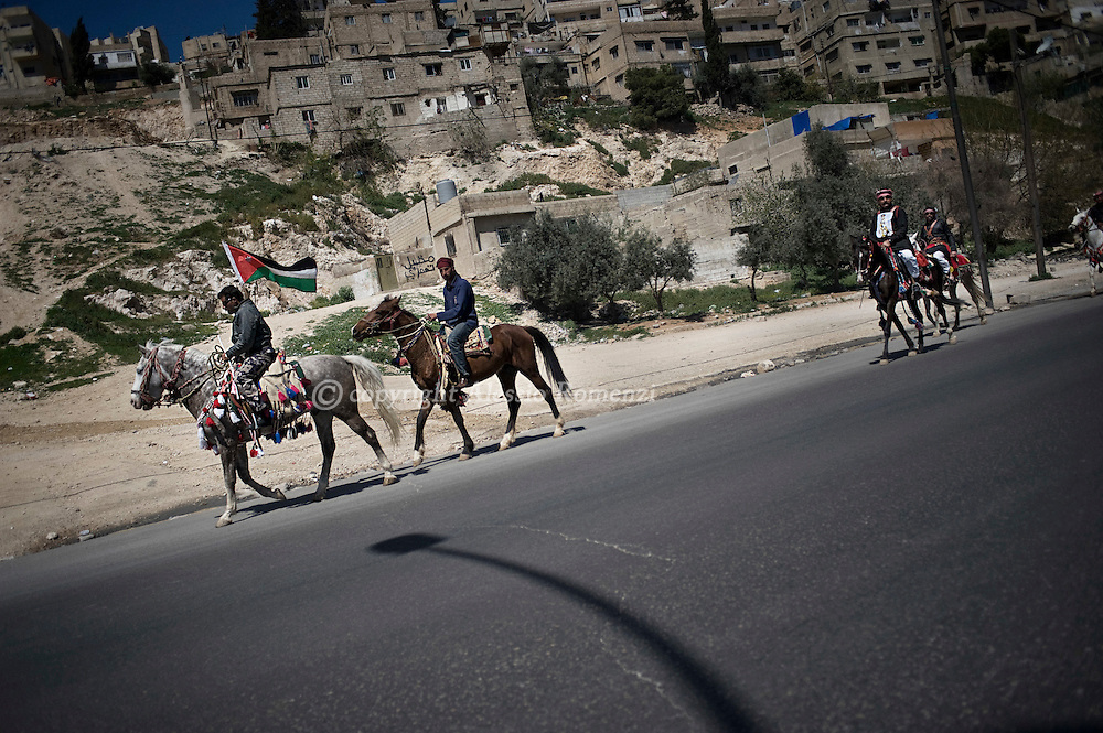 JORDAN, Amman : Jordanian horse men on the streets of Amman on March 27, 2011 as Jordan's Islamist opposition, leftists and trade unions demanded the ouster of Prime Minister Maaruf Bakhit, blaming him for violence that has killed one person and injured 130.ALESSIO ROMENZI