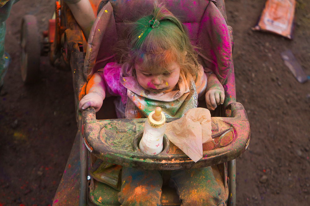 The Holi Festival of Colors, at the Lotus Temple, in Spanish Fork Utah, is a family festival which many parents bring their children to even considering the array of  thick color filling the air, on Saturday, Mar. 24, 2012. (Photo by Benjamin B. Morris ©2012)