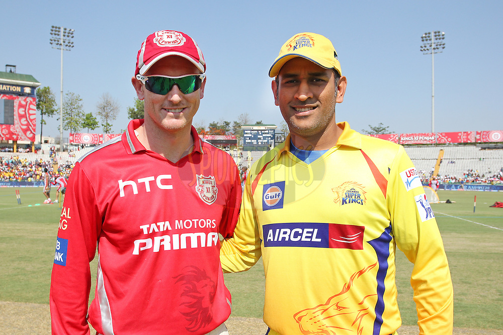 Kings XI Punjab captain George Bailey and Chennai Super Kings Captain MS Dhoni during match 53 of the Pepsi IPL 2015 (Indian Premier League) between The Kings XI Punjab and The Chennai Super Kings held at the Punjab Cricket Association Stadium in Mohali, India on the 16th May 2015.<br /> <br /> Photo by:  Shaun Roy / SPORTZPICS / IPL