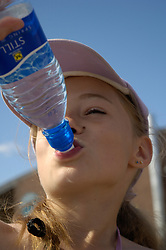 Girl drinking still bottled mineral water UK