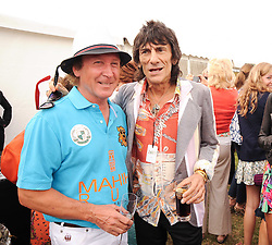 Asprey World Class Cup polo held at Hurtwood Park Polo Club, Ewhurst, Surrey on 17th July 2010.<br /> Picture shows:- KENNEY JONES and RONNIE WOOD