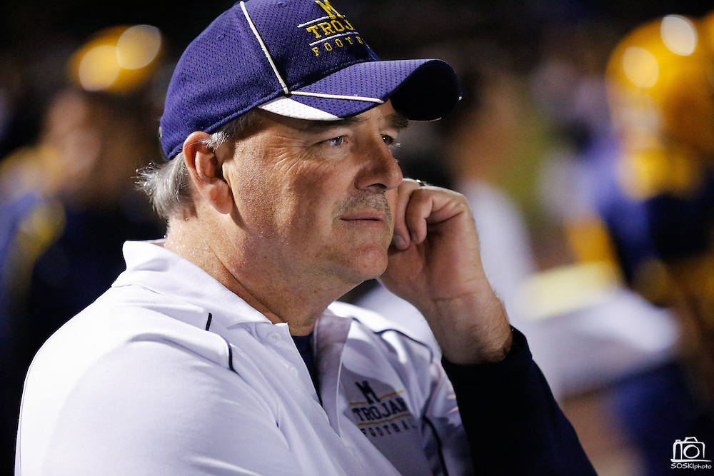 Milpitas High School head coach Kelly King watches a play unfold from the sideline against Sacred Heart Cathedral at Milpitas High School in Milpitas, California, on September 20, 2013. The Trojans beat the Fightin' Irish 28-21. (Stan Olszewski/SOSKIphoto)