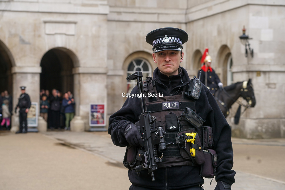 Union flags flies at half mast over Parliament with heavy arms polices presents after-mast knifes attacks killed 5 people included on 23th March 2017, London,UK. by See Li