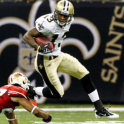 August 12, 2011; New Orleans, LA, USA; New Orleans Saints wide receiver Joe Morgan (13) runs past San Francisco 49ers safety C.J. Spillman (27) on a punt return during the first half of a preseason game at the Louisiana Superdome. Mandatory Credit: Derick E. Hingle