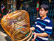 16 MAY 2017 - BANGKOK, THAILAND: Sarayut Nilbai, who makes and repairs birdcages, says he is the third generation of his family to live in the Pom Mahakan slum. He is varnishing a bird cage he made in his home workshop. The final evictions of the remaining families in Pom Mahakan, a slum community in a 19th century fort in Bangkok, have started. City officials are moving the residents out of the fort. NGOs and historic preservation organizations protested the city's action but city officials did not relent and started evicting the remaining families in early March.           PHOTO BY JACK KURTZ